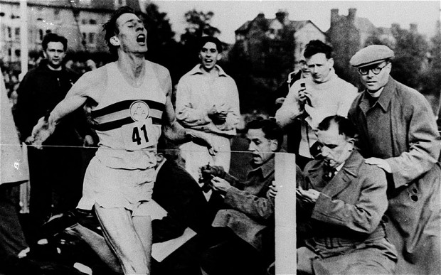 Roger Bannister hits the tape after running the first four-minute mile
